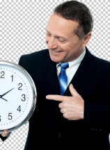 Smiling man holding a clock in his hands