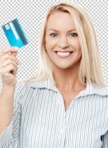 Smiling female model holding up credit card.