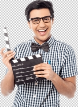 Smiling man holding a movie clap