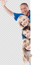 Joyful family of four behind blank whiteboard