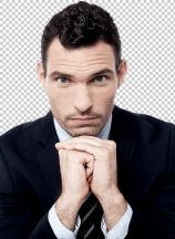 Businessman posing to camera while having a deep thought